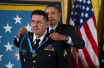 Spc. Santiago J. Erevia is awarded the Medal of Honor by President Barack Obama during a ceremony in the East Room of the White House in Washington, Tuesday, March 18, 2014. President Obama awarded 24 Army veterans the Medal of Honor for conspicuous gallantry in recognition of their valor during major combat operations in World War II, the Korean War and the Vietnam War. (AP Photo/ Evan Vucci)
