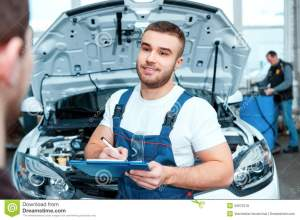 car-mechanic-service-station-confident-portrait-handsome-speaking-his-client-putting-information-his-50872518